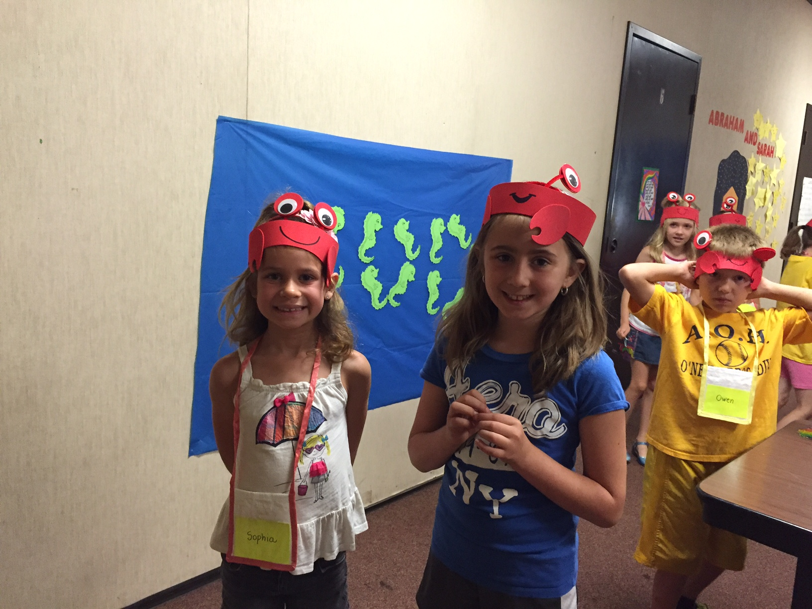 images/stories/HeaderImages/Frame2/Sophia and Isabella in crab hats.JPG